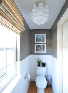 @Centsational Girl brought high contrast to her bathroom with moody mushroom gray walls, classic white beadboard, and both modern and traditional accessories. Via MyColortopia.com