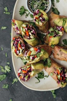 Fresh zucchini summer rolls featuring raw zucchini tossed with shredded purple cabbage and a lovely garlicky herb mixture. Perfect for a light lunch!