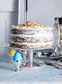 This three-layer carrot cake is filled between tiers, but the outside is left exposed in the style of a naked cake.