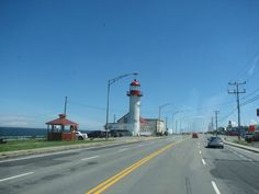 Approaching on Highway 17 (Trans-Canada Highway) ...Matane Lighthouse  (Phare de Matane), Matane, Québec, Canada - part of my childhood memories. . . with an observation picnic deck to look over the sea while you eat. . .