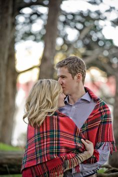 Love the red plaid blanket for Colorado winter engagement session