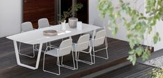 Loop chair and Air table by MANUTTI - exclusive Belgian outdoor furniture. The Loop is a lively, elegant and light chair collection. Upholstered with high quality nautical fabrics in Alcantara®, Terry or white leatherette, ensuring welcoming ambiance in any imaginable place. Matching Air table.