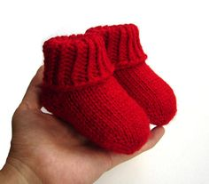 These soft socks are hand knit from warm wool and acrylic blend yarn. I made them toe-up so there are no seams and are very comfortable and stretchy.