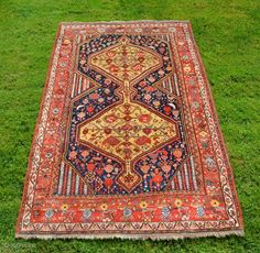 """Antique Khamseh pile rug, 81"""" X 50"""". Circa 1900. Yellow medallions on indigo ground with unusual elegant border. Highly saturated natural dyes including beautiful reds and yellow. Original finishes including kilim ends. ..."""