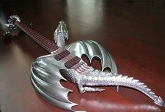 "Today we want to show you something really creative - custom guitar in the form of dragon. This chrome metallic dragon ""Draco"" guitar was created by Emerald Guitars Wang Leehom, Grateful Dead Songs, Guitar Sketch, Drum Chair, Cool Electric Guitars, Vox Machina, Unique Guitars, Drum Lessons, Guitar Collection"