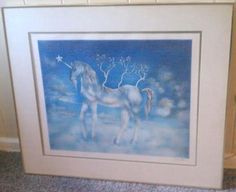 Salvador Dali  Happy Unicorn  litho signed and stamped. Measures 34  x 29   in the frame. The litho itself measures 21.5   x 25.5.   Comes with a letter of authenticity. Print in mint condition. Numbe