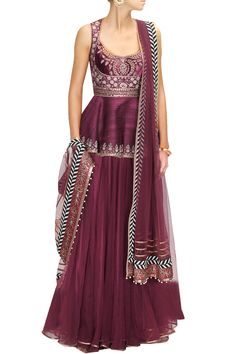 This Maroon embroidered lehenga set features in raw silk top with embroidered…