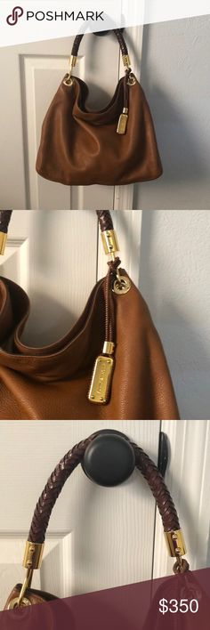 """Michael Kors Scorpios Collection Handbag Barely worn Michael Kors Skorpios Large Shoulder Bag!  Genuine Leather with a hand braided Italian Leather top handle. Shell textured leather with mocha leather trim. Golden hardware. Woven shoulder strap with rings; 9 1/4"""" drop. Woven hanging logo tag. Slouchy body style complements day or night looks!  13""""H x 14""""W x 6""""D. Original tag included, purchased for $895 originally. Very clean interior with a zip pocket on one side and two open pockets on…"""