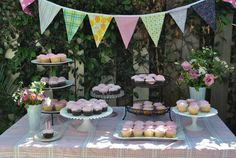 lulu's pink cupcake table with the buntings we made!  :)