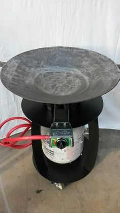 "Cowboy Wok Grill aka Discada. These are brand new disc not used in agriculture. This grill is 24"" round. The cart supports both the bottle and the burner allowing you to move it around freely. Great addition to backyard BBQ's."