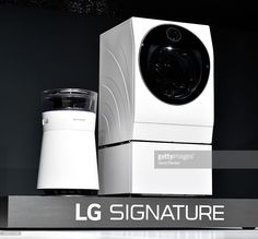 The LG Signature air purifier and washing machine are displayed during a LG press event for CES 2016 at the Mandalay Bay Convention Center on January 5, 2016 in Las Vegas, Nevada. CES, the world's largest annual consumer technology trade show, runs from January 6-9 and is expected to feature 3,600 exhibitors showing off their latest products and services to more than 150,000 attendees.