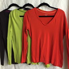 Set of 3 long sleeve Lands End v neck shirts Includes lime green, orange, and dark brown. Long sleeve v neck. Size L (14-16). Would prefer to sell as a set but willing to break up Lands' End Tops Tees - Long Sleeve