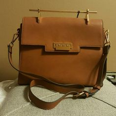 Brown purse with gold embellishment Can be used as a cross bag or without the straps la Terre  Bags