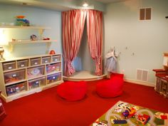 Built in stage in playroom - cute idea but not sure if I could do this in the living room.  Maybe with a thin or more neutral fabric?
