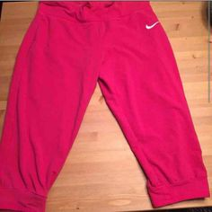Pink Nike Dri Fit capri jogger pants EUC sz L These are in EXCELLENT preowned condition. Pretty sure I've only worn them once, MAYbe twice, tops. Sz L waist band folds down to say JUST DO IT. I only had pics already taken from an older post on another app, but I will update with new pics tonight Nike Pants Track Pants & Joggers