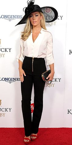 Last Night's Look: Love It or Leave It?   KENDRA WILKINSON   in a surprisingly low-key look for the Kentucky Derby, including black front-zip trousers, a white blouse with sheer paneling, an Erin Dana clutch, red heels and a dramatic wide-brim black hat.