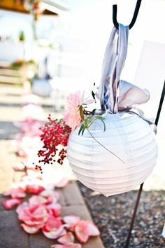 Hang a lantern with ribbon and stick floral stems in it for aisle decor. #weddingceremony #aisledecor #weddingchicks Event Design: Mark Christopher Weddings ---> http://www.markchristopherweddings.com/