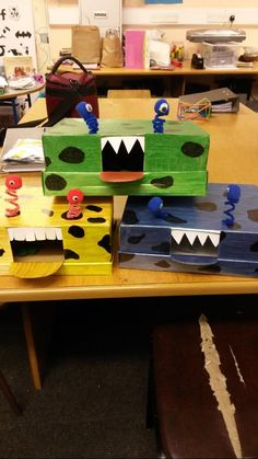 Monsters! The kids get to feed the monsters pom poms if they get words/phonics/maths correct. Works like a puppet really but something a little different :)