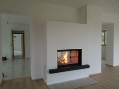 A very hot thing. See-through fireplace between kitchen and living room. A very hot thing. See-through fireplace between kitchen and living room. See Through Fireplace, Stove Fireplace, Modern Fireplace, Houzz, Bedroom Wall, Townhouse, Sweet Home, Living Room, Kitchen Living