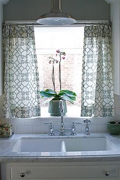 trellis fabric curtains! gorgeous! lamp above sink! so many things i love! light countertops, grey walls! everything! would look great with an apron front sink as well!