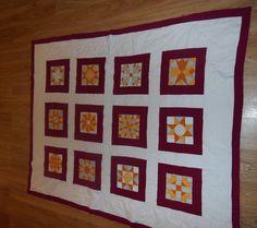 patchwork, quilt, plaid , qui  me sert de jeté de canapé ou dessus de lit. carré fait main, surpiqure  main ,le reste mac.