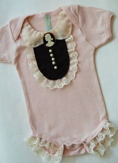 i know you don't like pink much but i totally dig this fancy baby onsie,  how cute in navy or cream too! -- @Megan Liljenquist