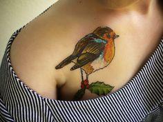 Heb wel eens mooiere tattoos gezien. Het idee is very nice: Robin & Holly. (Nog wat Japanse bloemen erbij)
