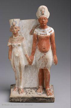 Akhénaton et Néfertiti après 1345 avant J.-C. (après l'an 9 du règne) Musée du Louvre. Much of Egyptian dress featured jeweled pectorals. The dress I've chosen from Elie Saab's most recent couture collection draws from those influences.