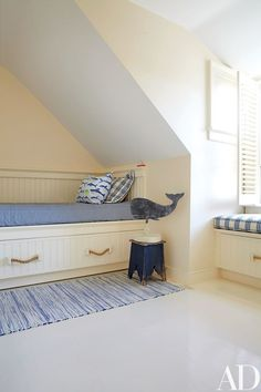 A weather vane from Nina Hellman Antiques stands guard over a custom-made trundle bed in a children's room   archdigest.com