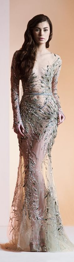 Long Sleeve beaded evening gown. We can replicate this sheer design for you.  If your dream evening gown is heavily beaded like this one and is out of your price range email us a picture. Our US firm specializes in affordable replicas of haute couture evening dresses and custom designs.  https://www.dariuscordell.com/featured/long-sleeve-evening-dresses-ball-gowns/