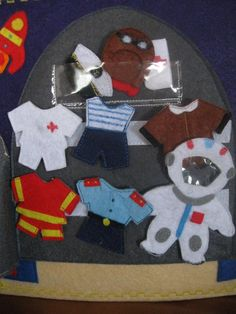 The cabinet-rocket hanging form (overalls) for 6 professions: doctor, firefighter, captain, pilot, astronaut, policeman.
