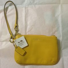 Small coach wristlet in sunflower yellow New! Sunflower wristlet large enough to fit any smartphone Coach Bags Clutches & Wristlets