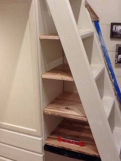 Finally got the shelves under our stairs installed. We made them out of scrap pieces from our floor… Very Whitman of me!