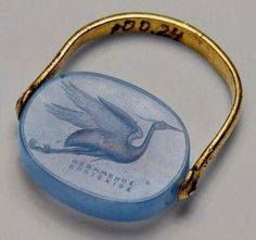 """Greek gold ring featuring a blue chalcedony carved with a flying heron. The tiny text reads """"Made by Dexamenos of Chios"""" - a prolific and talented ancient jewelry designer who's signature which appears on a number of Greek Jewelry, Old Jewelry, Jewelry Art, Antique Jewelry, Vintage Jewelry, Jewelry Accessories, Viking Jewelry, Gemstone Jewelry, Bags Online Shopping"""