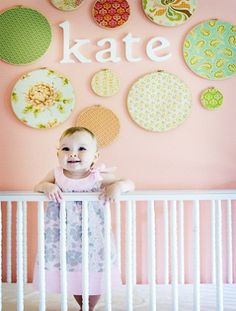 embroidery hoops covered with fabric - cheap wall art that is super cute.