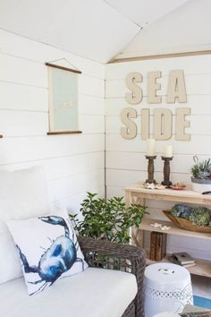 Planked walls, lots of sea shells, and relaxing candles make the inside a coastal oasis. Pale sea glass colors and vintage charts adds a nod to the style's origins. See more at Finding Silver Pennies Coastal Cottage, Coastal Homes, Coastal Decor, Coastal Style, Nantucket Style, Cozy Cottage, Coastal Living, Shed Interior, Interior Walls