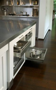 A shelf above the range conveniently stores commonly used items for cooking, and the island has pull-out shelves to easily access pots & pans