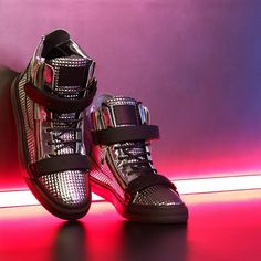 Chrome  Embossed metallic leather reflecting the Disco lights.