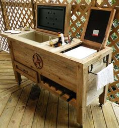 Weathered Wood Ice Chest - with additional counter space and a wine rack and wheels that make it easy to move. This is a clever way to hide an unattractive cooler  - Outdoor Kitchen