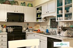granitepaintedcountertops3 with Giani Granite paint.   white cabs, black appliances with white counter and aqua accents