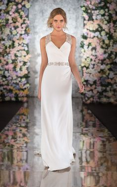 Martina Liana 553 This Silk Moroccan open back wedding dress exudes Grecian appeal with its sleek slim silhouette and spectacular, Diamante encrusted racer-back straps and silk-covered buttons will ensure your exit will be just as dramatic. The flowing Silk skirt is accented at the waist by a gorgeous hand-beaded Diamante band, while slight ruching on the bodice and hip accentuates the natural curves of the body. This open back wedding dress also features a built-in court train
