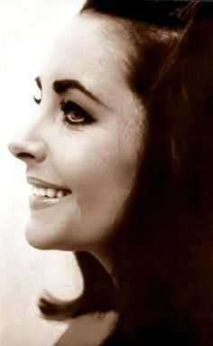 Elizabeth Taylor. It's a bit ridiculous how much she looks like an older version of my cousin in this picture.