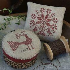 ..cute x stitch pincushions