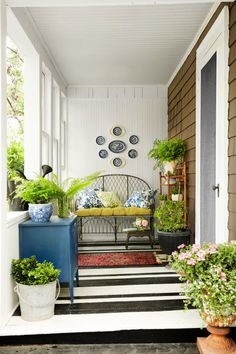 The graphic black-and-white pattern in this California home brings punch to the narrow porch.