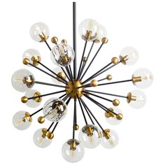 A sputnik inspired light fixture, the Larue features a matte black and antique brass fixture with a clear glass globe over each bulb and a 40 Lantern Chandelier, Ceiling Chandelier, Black Chandelier, Ceiling Lights, Chandeliers, Chandelier Ideas, Ceiling Ideas, Mid Century Lighting, Transitional Wall Sconces