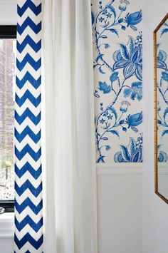 Stunning royal blue and white kitchen with wall above chair rail papered in Thibaut Donegal Blue and White Wallpaper. Sarah Richardson kitchen Kravet blue chevron drapery fabric