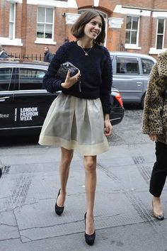 street style alexa chung | Alexa Chung in a creamy white skirt and textured navy sweater; Image ...
