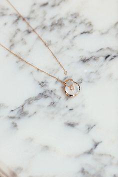Park & Cube, Dress – Dagmar. Necklace - Amulette de Cartier. Hat – Chanel. Heels – Gianvito Rossi