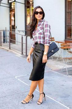 Outfits to wear to the office starring the classic pencil skirt - see how our favorite bloggers and street style stars are wearing them now (like a leather style with a plaid shirt)