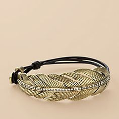 The Fossil® Rare Feather Bracelet, Our antiqued brass-tone feather and chocolate brown leather wrist wrap is a charming vintage-inspired must-have. Buy the Fossil Rare Feather Bracelet Now! Leaf Jewelry, Cute Jewelry, Jewelry Box, Jewelry Bracelets, Jewelry Accessories, Fashion Accessories, Fashion Jewelry, Bangles, Jewlery